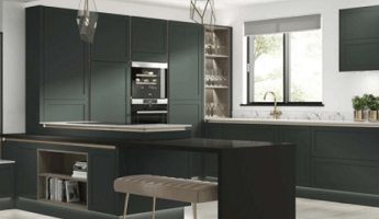 A Wickes kitchen with a dark green and black colour scheme