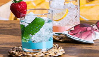 Rinkit glasses with summer drinks and a strawberry on rim