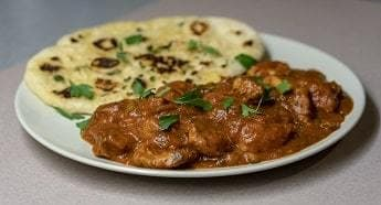 A Plate of Curry with a Naan Bread